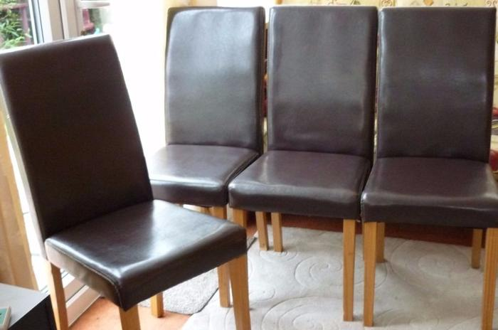 4 BROWN FAUX LEATHER DINING CHAIRS IN GOOD CONDITION.