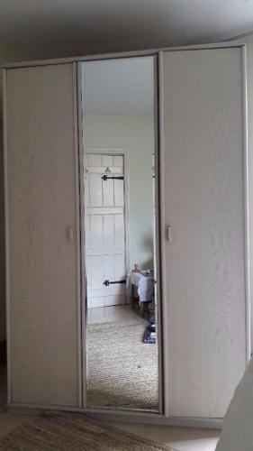 Double Wardrobe with white wood grain finish . 3 doors