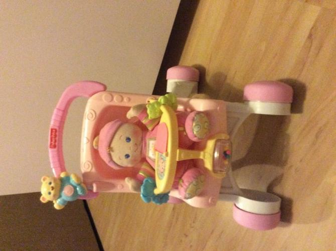 Fisher price soft doll and musical pushchair