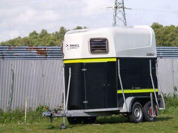Horse box, horse trailer.