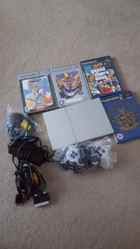Silver slim ps2 with games including spyro