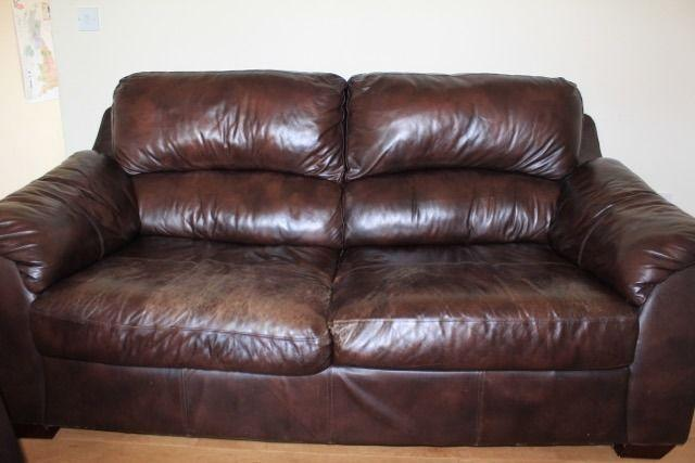 Two double seater chocolate leather sofas