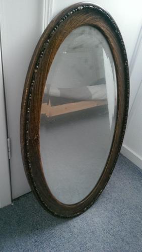 Vintage Antique heavy oval mirror with dark wood