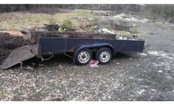 14 foot twin wheel beaver tail trailer tows fine will