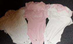 7 white vests 7 pink vests above with a mixture of