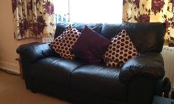 Black 2 and 3 seater sofa for sale. From a smoke and