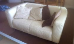 Cream 2 and 3 seater sofas. Possible delivery. If phone