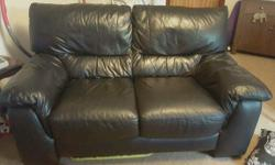 2 seater black leather sofa Excellent condition From a