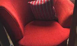 1 plain red and 1 grey and red swivel chair in very