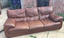 2 light brown leather 3 seater sofas. Used, general