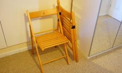 Two foldable wooden chairs. Used only twice, so they