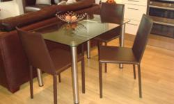 3 brown leather dining chairs. ( cost 100 each ) as