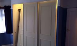 3 cream sliding wardrobe doors complete with runners.