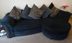 4 seater cushion back sofa in black Cuddle chair that