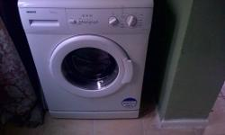 5kg with a 1000rpm A+Aclass white washing machine very