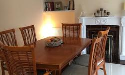 Dining table exends to seat 8 comfortably but has