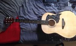 This cb Sky acoustic guitar is in good condition and