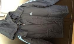 This Adidas coat is new never been worn hanging in my