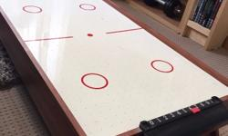This air hockey table is in full working order and it