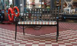 Antique black iron bench with beautiful new purpose