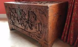 Large solid wooden trunk with detailed carving an all