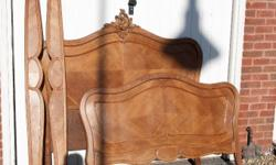A 19th century french walnut double bed. The head and