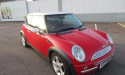 WE HAVE FOR SALE THIS TIDY MINI COOPER 2001 IN RED IN