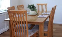 Beautiful solid oak dining table and 4 upholstered