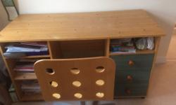 Oak coloured laminate desk with three drawers. Would