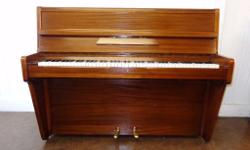 This Berry upright piano has been restored. It is a