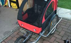 Bike trailer or stroller. Has handle to push as well as
