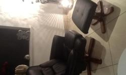 Black faux leather swivel-recliner chair & footstool to