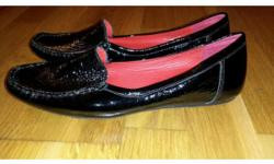 Black, shiny leather, size 4.5 Clarks shoes. Flats.