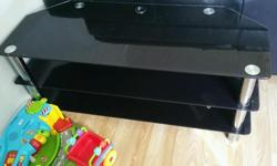 "Large black glass TV stand fits upto 50"" tv"