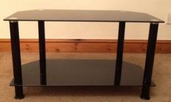 Black glass tv stand . Height 15.5 inch. Length 27.5