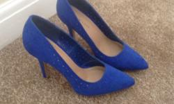 Blue heeled suede effect court shoe from New Look. Worn