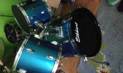 Full drum kit including dampners as shown in a few of