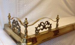 Enhance your hearth with this ornate brass fender. The