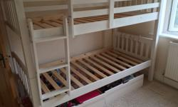 Set of white bunk beds, a few marks on the wood as