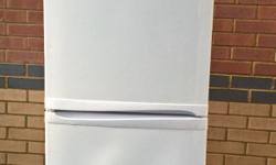 This fridge freezer is white in colour and the make is