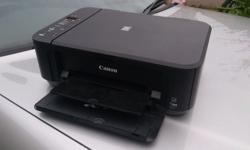 HERE UP FOR SALE MY CANON MG2250 PRINTER/ SCANNER. IT'S