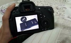 Canon dslr eos 60d in good condition. includes: body