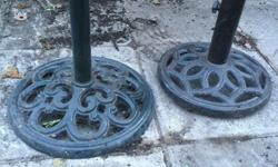 Selling these cast iron umbrella bases. Choice of two.