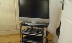 CHROME TV STAND WIH 3 GLASS SHELVES. IMMACULATE