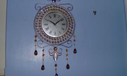 wall mounted clock, keeps good time, with amber stones