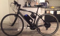 Nearly new custom made Specialized Sirrus ebike with a