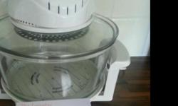 New never used halogen cooker with recipe book