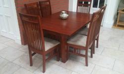 Solid wood dining table and six chairs. Contemporary