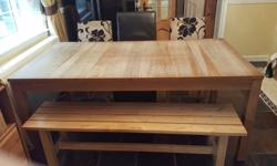 Large oak dining table and 4 high back faux leather