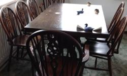 Table and 6 chairs and two carvers in solid Oak. Table